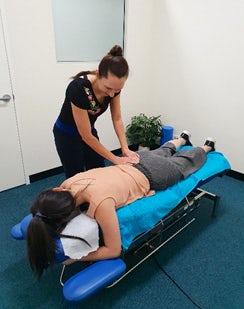 Dr Schiller makes a chiropractic adjustment