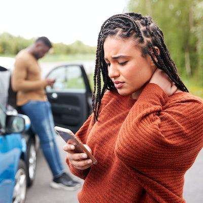 Female Motorist Involved In Car Accident Calling I