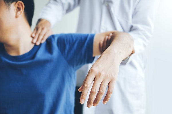 Physical Doctor consulting with patient About Shou