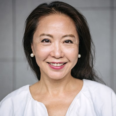 Attractive senior Chinese woman smiling
