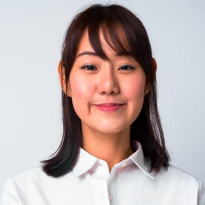Portrait of beautiful Asian businesswoman against