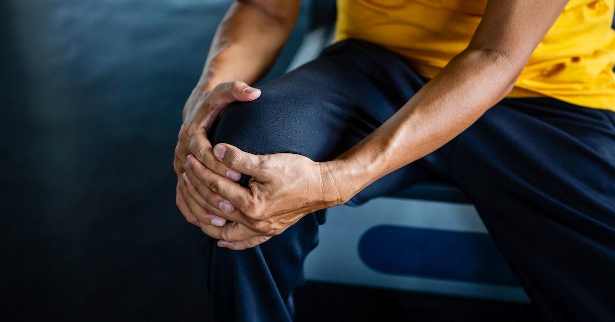 Senior asian sport man injury knee pain  sitting o