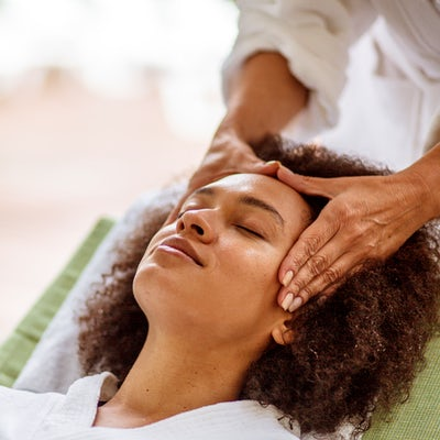 Woman relaxing during head massage