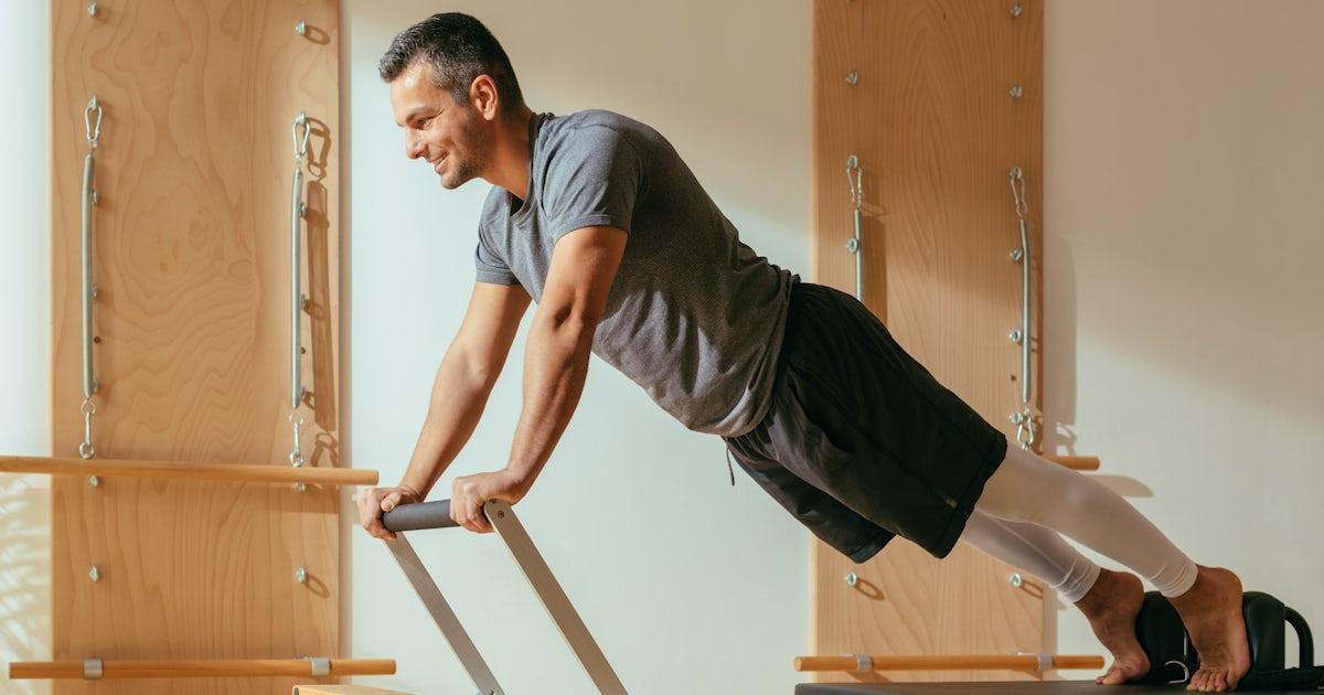 A Man Doing Reformer Pilates