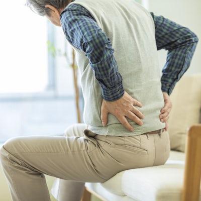 Senior man hurting his back