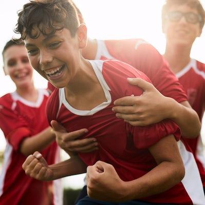 A soccer player celebrates a goal.