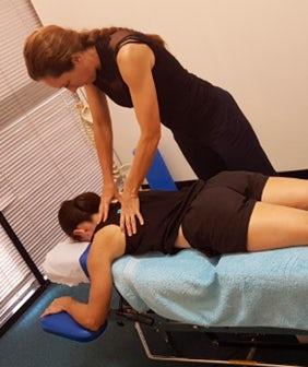 dr linda schiller performing chiropractic adjustment